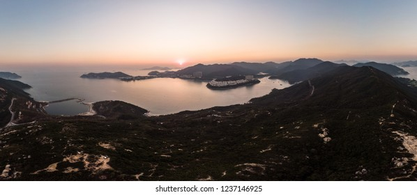 Aerial panorama of the sunset over Dragon's back hiking trail in Hong Kong island, with Stanley peninsula in the background