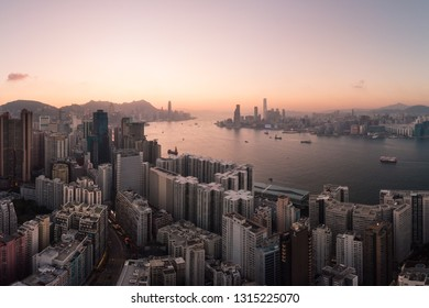 Aerial panorama of the sunset over Hong Kong island North Point district and Kowloon across the Victoria harbor in Hong Kong, China