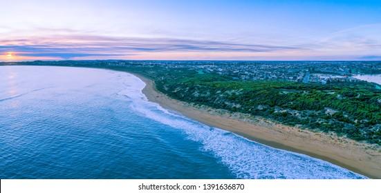 Aerial panorama of sunset over Warrnambool Ocean coastline in Victoria, Australia