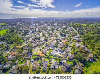 Aerial panorama of town houses near ocean bay on bright sunny day