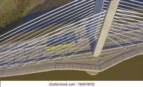 Aerial panorama of a trolley and cyclist on suspension bridge, the Tilikum Crossing Bridge in Portland, Oregon