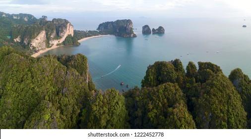 Aerial panorama of tropical turquoise lagoon, beach between rocks and islands, Krabi, Railay beach, Thailand