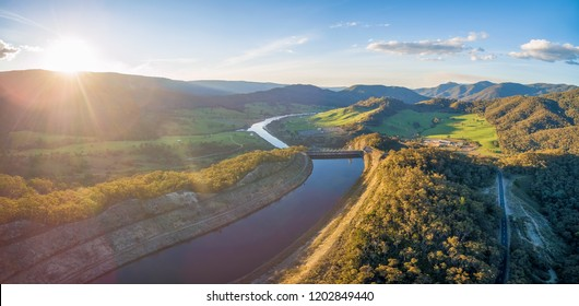Aerial panorama of Tumut river and power station in beautiful scenic landscape at sunset. NSW, Australia