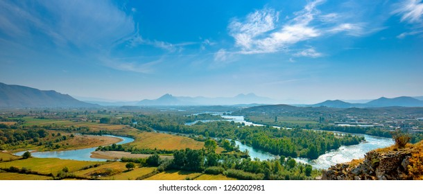 Aerial panorama view of the Buna River after the confluence with the Drin River from Rozafa Castle, Shkoder, Albania. Meandres and mountain. Beautiful Landscape