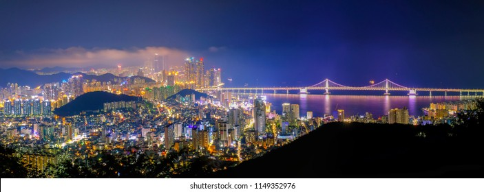 Aerial panorama view of Busan city with Gwangan bridge at night, South Korea.