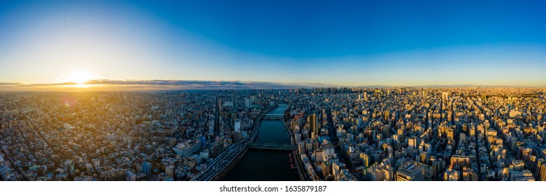 Aerial panorama view by drone of Tokyo Cityscape on sunrise.  in Tokyo, Japan. Panoramic view of buildings in Tokyo city - Shutterstock ID 1635879187