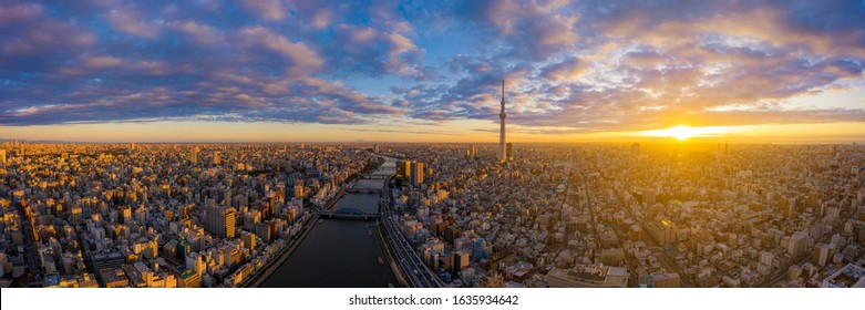 Aerial panorama view by drone of Tokyo Cityscape with Tokyo Sky Tree visible in Tokyo city, Japan on sunrise. Panoramic Dawn view of Tokyo city. Senso-Ji Temple with Sumida river in Japan. - Shutterstock ID 1635934642