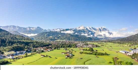 Aerial panorama view of Garmisch Partenkirchen Village with view of Zugspitze in fog