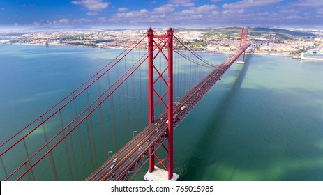 Aerial panorama view over the 25 de Abril Bridge. The bridge is connecting the city of Lisbon to the municipality of Almada on the left bank of the Tejo river, Lisbon
