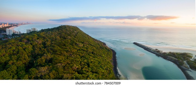 Aerial panorama view over Tallebudera Creek entrance and Burleigh Headland at sunrise