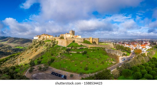 Aerial panorama view of Palmela castle pousada with stunning blue sky and old wind mills near Setubal Portugal