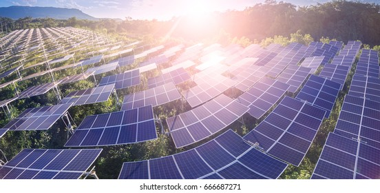 Aerial panorama view of Solar panels (solar cell) in solar farm to create the clean electric power.