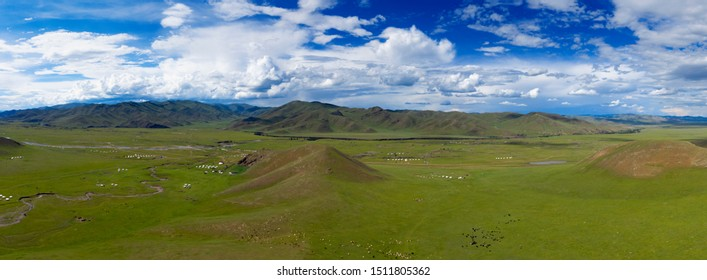Aerial panorama view of yurts in steppe and mountains landscape in Orkhon valley, Mongolia
