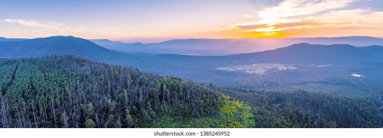 Aerial panorama of vivid sunset over mountains in Victoria, Australia