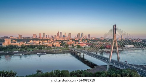 Aerial panorama of Warsaw, Poland at sunrise including Swietokrzyski Bridge over the Vistual river and City center in a distance