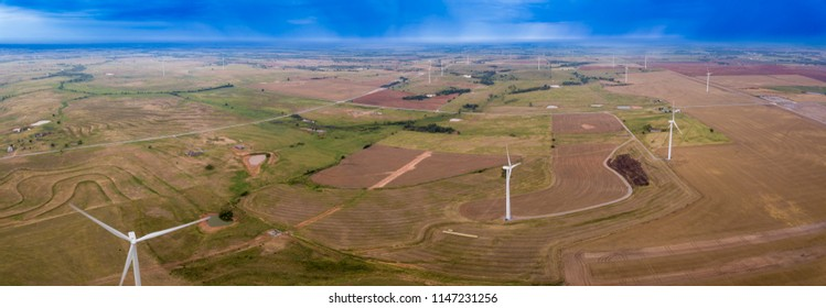 Aerial panorama of wind turbines and rain clouds in Oklahoma, USA.