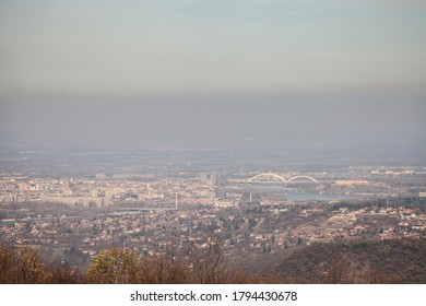 Aerial panoramal of Novi Sad, seen from a hill of Fruska Gora National park, with a focus on the Danube and the main bridges connecting the city. Novi Sad is the capital city of Vojvodina  - Shutterstock ID 1794430678