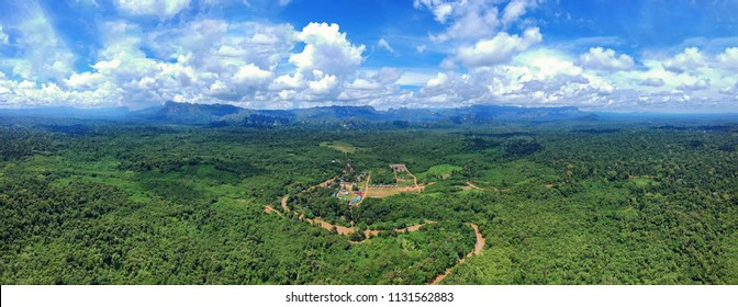 Aerial panoramatic view of traditional Dayak Merabu village in heart of jungle near the river with mountains in the back in the North Kalimantan (Borneo), Indonesia
