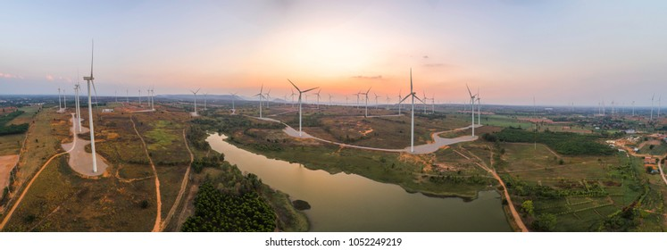 Aerial panoramic beautiful sunset scene with wind turbine field on the plain area in Thailand