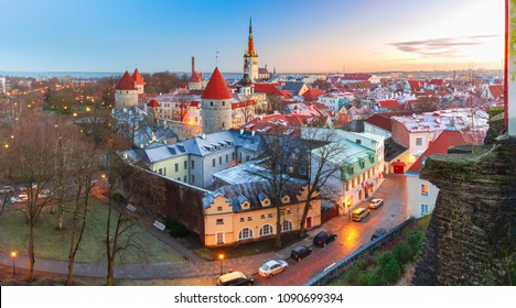 Aerial panoramic cityscape with Medieval Old Town, St. Olaf Baptist Church and Tallinn City Wall in the morning, Tallinn, Estonia