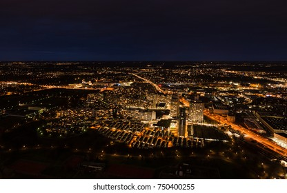 Aerial panoramic cityscape view with bright lights in night Munich