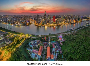 Aerial panoramic cityscape view of HoChiMinh city and the River Saigon, Vietnam with blue sky at sunset. Financial and business centers in developed Vietnam