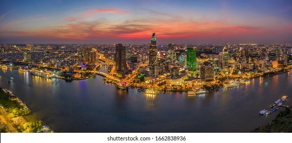 Aerial panoramic cityscape view of HoChiMinh city and the River Saigon, Vietnam with blue sky at sunset. Financial and business centers in developed Vietnam. View from Thu Thiem peninsula