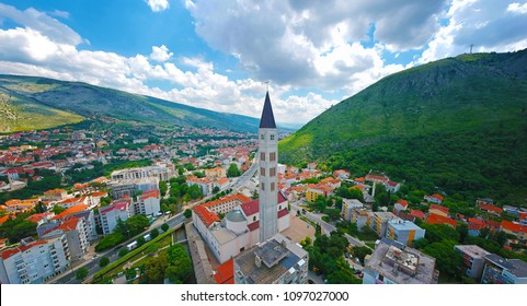 Aerial panoramic cityscape view of  Mostar Peace Bell Tower (Mostarski Zvonik Mira) in Bosnia and Herzegovina
