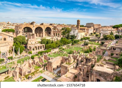 Aerial panoramic cityscape view of the Roman Forum and Roman Colosseum in Rome, Italy. World famous landmarks in Italy during summer sunny day.