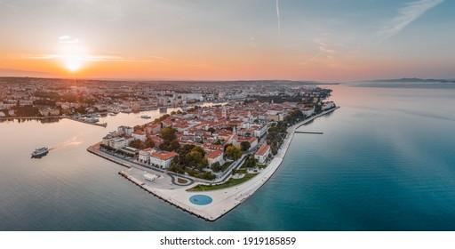 Aerial panoramic drone shot of Zadar old town sea organ in sunrise hour in Croatia Dalmatia area - Shutterstock ID 1919185859