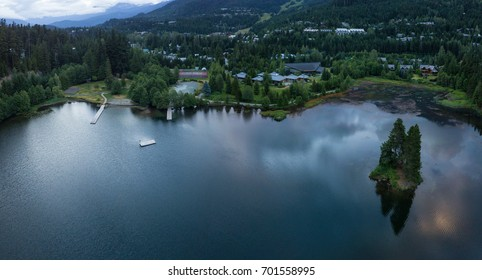 Aerial panoramic landscape of Alpha Lake in Whistler City, British Columbia, Canada, during a cloudy morning sunrise.