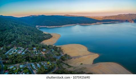 Aerial panoramic landscape of Lake Burrinjuck and holiday park at sunset. NSW, Australia
