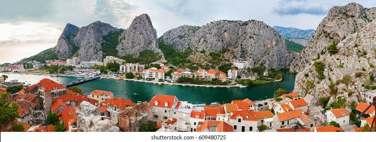 aerial panoramic landscape of the small town Omis surrounded with mountains, Makarska Riviera, Croatia