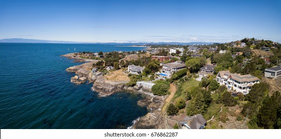 Aerial panoramic landscape view of a beautiful rocky shore on Pacific Coast. Taken in Victoria, Vancouver Island, British Columbia, Canada.