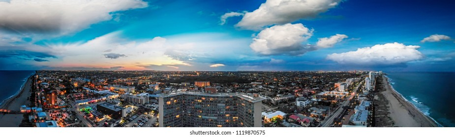 Aerial panoramic night view of Boca Raton skyline at dusk, Florida.