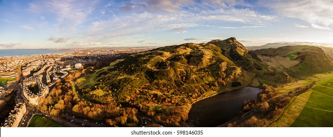 Aerial panoramic photograph of Edinburgh's Arthur's Seat Hill what is situated just to the east of the city centre, about 1 mile (1.6 km) to the east of Edinburgh Castle. Scotland, United Kingdom