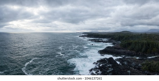 Aerial panoramic seascape view of a rocky Pacifc Coast during a gloomy winter sunset. Taken near Ucluelet, Vancouver Island, British Columbia, Canada.