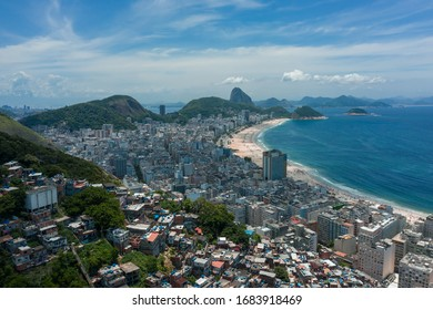 Aerial, panoramic shot of Copabana beach with Sugarloaf Mountain in the background