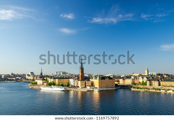 Aerial panoramic top view of Riddarholmen district, Riddarholm Church and typical sweden gothic buildings, boat ship sailing on water of Lake Malaren from Sodermalm with copy space, Stockholm, Sweden