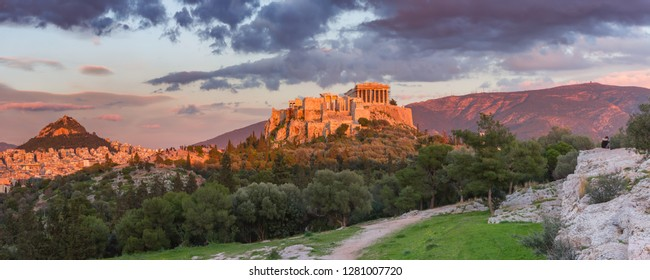 Aerial panoramic view of the Acropolis Hill with Parthenon and Mount Lycabettus at gorgeous sunset in Athens, Greece