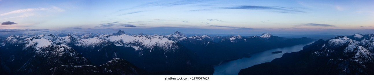 Aerial Panoramic View from Airplane of Canadian Mountain Landscape. Colorful Spring Sunset. Pitt Lake near Vancouver, British Columbia, Canada. Nature Backgrorund Panorama