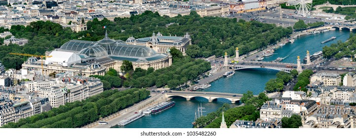 Aerial panoramic view of Alexandere III and Invalides bridges on Seine river and Grand Palais and Petit Palais  in Paris, France
