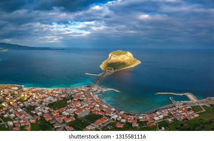 Aerial panoramic view of the ancient hillside town of Monemvasia located in the southeastern part of the Peloponnese peninsula - Majestic scenery of the medieval fortified castle town of Monemvasia