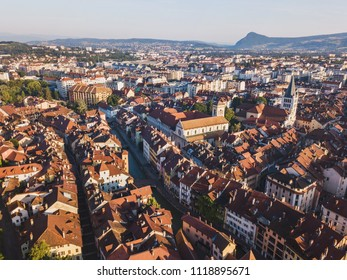 aerial panoramic view of Annecy city and Thiou river, France, historical landmark architecture of old town center, beautiful cityscape