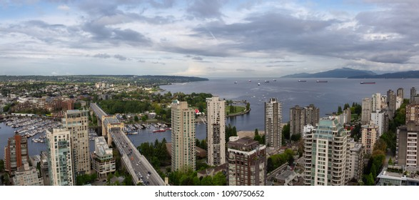 Aerial panoramic view of a beautiful modern cityscape during a cloudy day.Taken in Downtown Vancouver, British Columbia, Canada. High Quality and Resolution