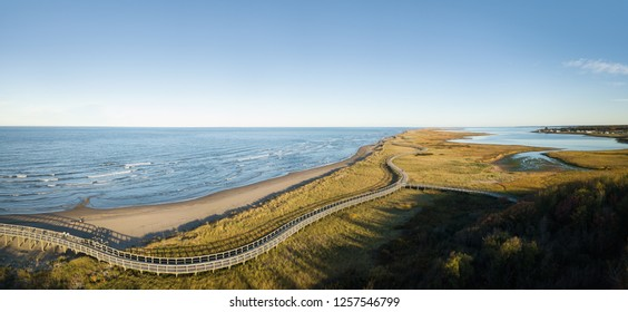 Aerial panoramic view of a beautiful sandy beach on the Atlantic Ocean Coast. Taken in La Dune de Bouctouche, New Brunswick, Canada.
