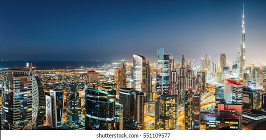 Aerial panoramic view of a big modern city by night. Business bay, Dubai,