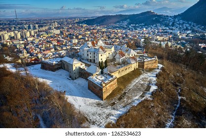 Aerial Panoramic view of the Citadel of The Guard in winter time in the old city Brasov from Transylvania, Romania, Transylvania landmark in Romania