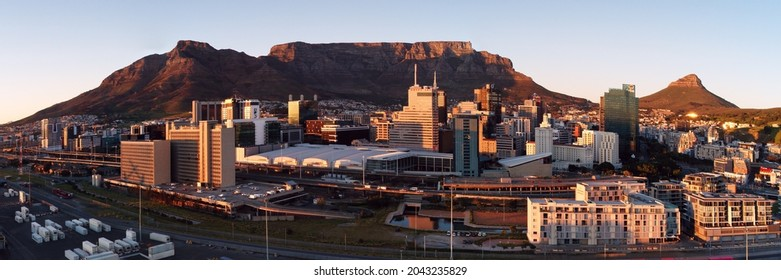 Aerial panoramic view of the City of Cape Town skyline at sunrise. Cape Town, Western Province, South Africa. 18 September 2021.