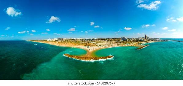 Aerial panoramic view of the coastal strip Bar Kokhva beach, Ashkelon, Israel at July 2019.